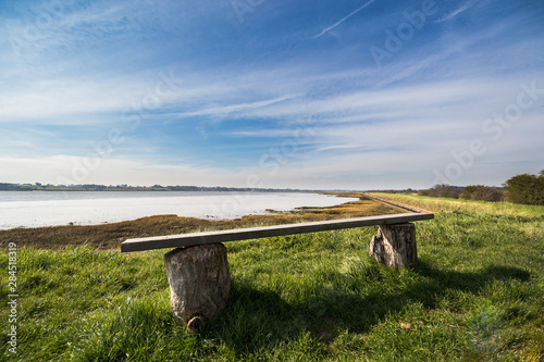 An empty bench in rural Suffolk countryside over looking the River Deben in Suff Canvas Print