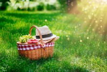 Picnic Basket With Raspberries, Grapes And Baguette