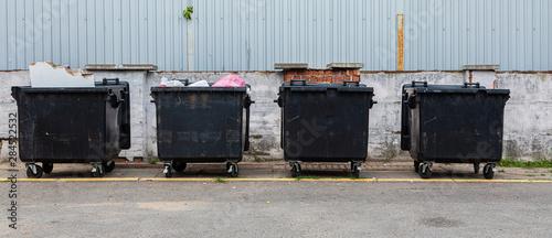 Black litter-bins on street, environmental pollution Wallpaper Mural