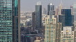 Aerial top view of Dubai Marina morning timelapse. Modern towers and traffic on the road