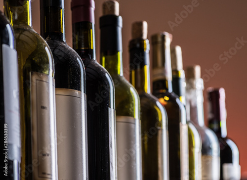 Obraz na plátně  Line of wine bottles. Close-up.