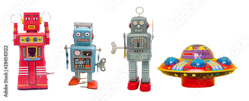 Fotografia isolated robots and a UFO retro tin toys