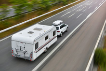 Travel On Car With Caravan Trailer By Highway