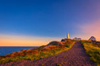canvas print picture - View of Cape Spear Lighthouse National Historic Site at Newfoundland Canada during sunset