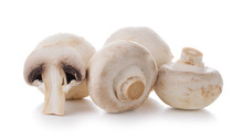 Group Of Champignon Mushrooms Isolated On A White Background