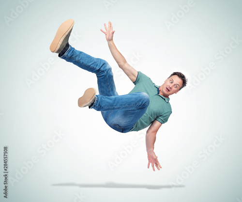 Situation, the man in casual clothes is falling. Concept of an accident Wall mural