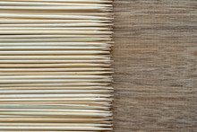 Pile Of Wooden Sticks Or Bamboo Skewers Used To Hold Pieces Of Food Together On Wood Background