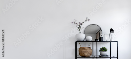Single modern black display in front of white wall Fototapet