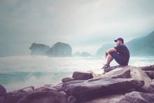 Asian Young Man Enjoys A Papuma Beach View