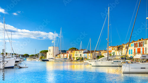 Foto auf Gartenposter Blau Jeans View Of Colorful Houses And Boats In Port Grimaud During Summer Day-Port Grimaud, France