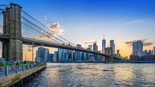 Brooklyn Bridge And Lower Manhattan While Sunset