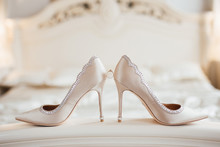 The Wedding Rings On The Bride's Shoes