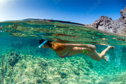 Woman snorkeling at Los Gigantes in Tenerife Canary Islands Spain