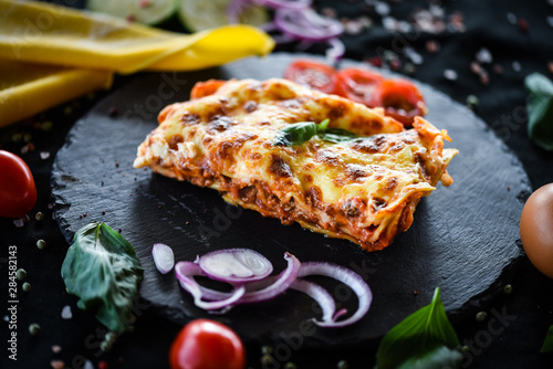 italian lasagna slice with fresh ingredients
