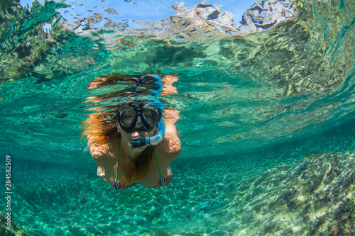 Woman snorkeling in the sea at Tenerife Canary Islands Spain