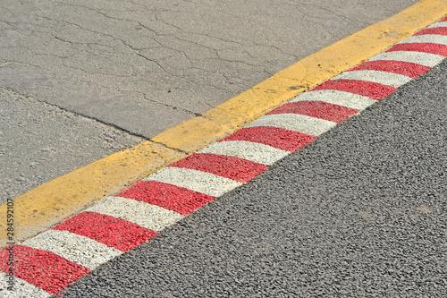 Photo red barrier line on asphalt, security area