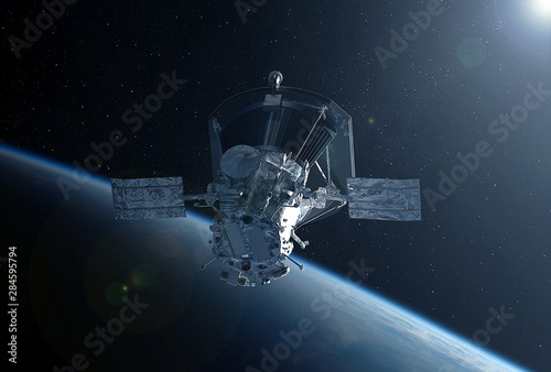 Obraz Large space satellite in space above the earth.  Elements of this image were furnished by NASA - fototapety do salonu