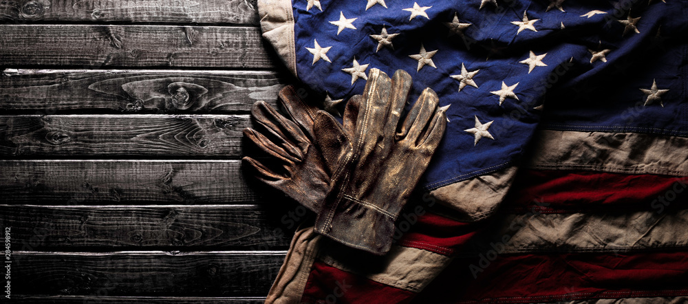 Fototapety, obrazy: Old and worn work gloves on large American flag - Labor day background
