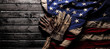 canvas print picture Old and worn work gloves on large American flag - Labor day background
