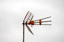 Antennas On A Roof Over A Clou...