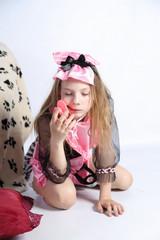 Obraz na płótnie Canvas little girl fashionista in her mother's big pink