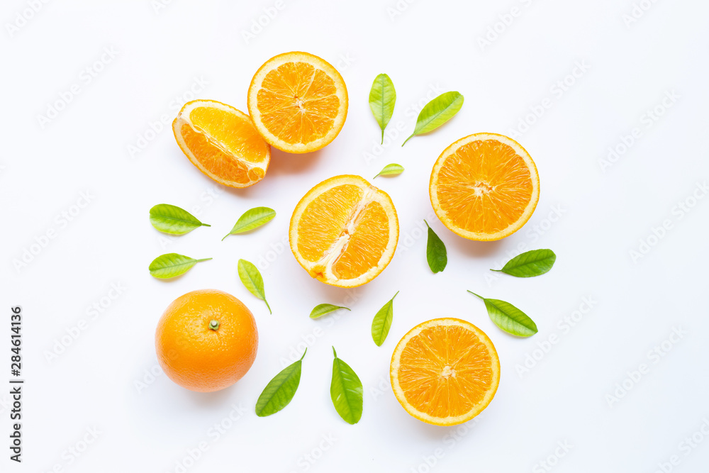 Fototapety, obrazy: High vitamin C, Juicy and sweet. Fresh orange fruit with green leaves  on white.