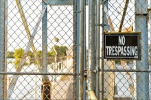 Sign No Trespassing Warning Sign On Chain Link Wire Fence