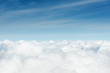 Leinwandbild Motiv above the cumuls clouds, blue sky background