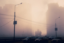 Beautiful Scene Of Morning City Street With Tough Traffic. Sunlight Through The Dense Fog Between High Buildings, And Small Christian Orthodox Church In Between. Kyiv. Ukraine.