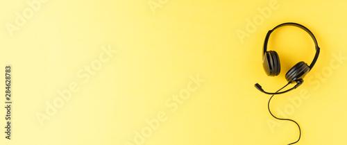 Obraz na plátně  Helpdesk headset on yellow background