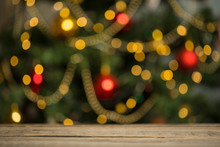 Rustic Wood Table In Front Of Christmas Light Night, Abstract Circular Bokeh Background