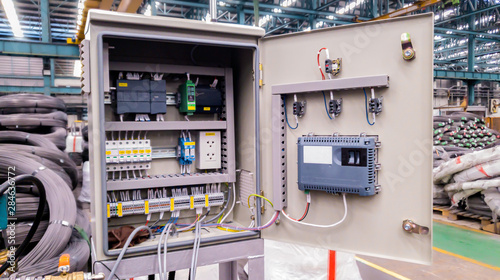 Blur background of power electricity control panel on factory site, Electrical switch cabinet, Main substation with breaker to control automatic system of machine