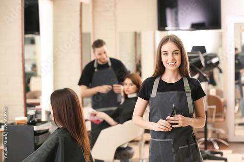Portrait of female hairdresser in salon Tableau sur Toile