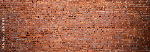 Foto auf Gartenposter Ziegelmauer Panoramic Old urban Red Brick Wall Background.