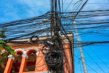 Huge Messy Tangle Of Dozens Of Electrical Cables At The Top Of An Electricity Pole, Cambodia