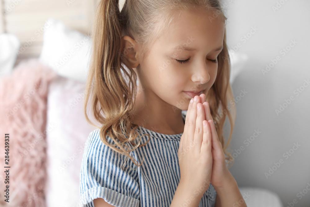 Fototapety, obrazy: Cute little girl praying in bedroom