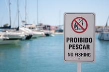 "Sign Saying ""Proibido Pescar"" (No Fishing) At The Marina In Vilamoura, Algarve, Portugal"