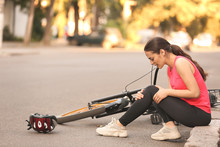Sporty Young Woman Fallen Off Her Bicycle Outdoors