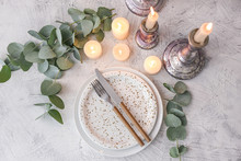 Beautiful Table Setting With Burning Candles And Floral Decor