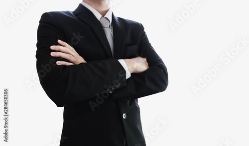 Fototapeta Businessman with arm crossed, isolated on white background