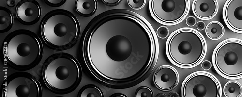 Multiple various size black Loudspeakers background. 3d illustration