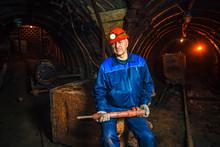 A Miner In A Coal Mine Stands ...