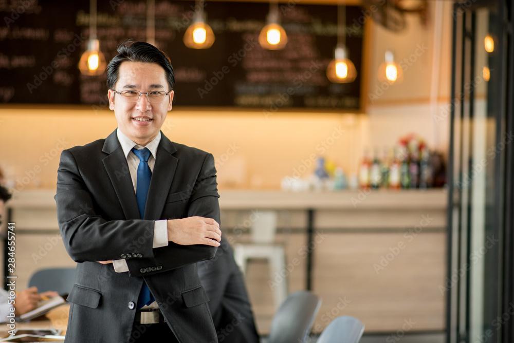 Fototapeta Portrait of happy asian  businessman.
