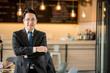 Leinwandbild Motiv Portrait of happy asian  businessman.