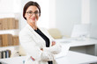 Leinwanddruck Bild - Portrait of a smiling young attractive business woman