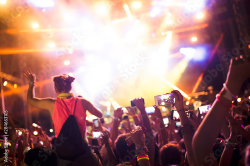 Obraz Portrait of happy crowd enjoying at music festival - fototapety do salonu
