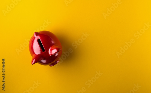Carta da parati  Red piggy bank on yellow background