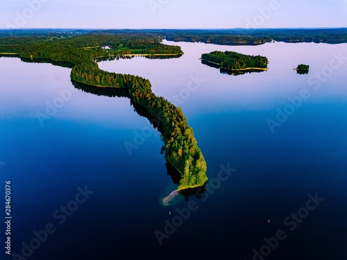 Fotografie, Obraz Aerial view of blue lakes with islands and green forests  in Finland