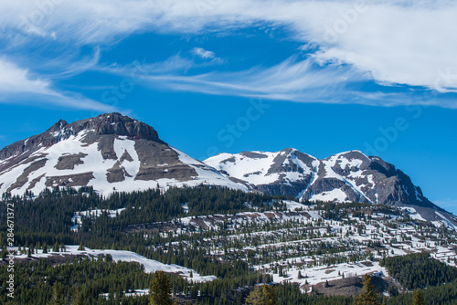 Low angle landscape of snow-dappled mountain in the San Juan Mountains of Colorado