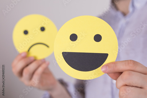 Poster de jardin Montagne Hand is selecting a happy mood smiley. In front of an empty room